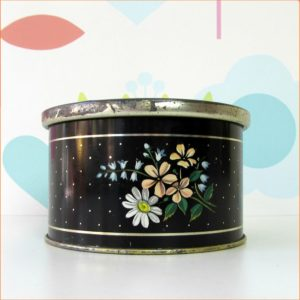Round black Lutti tin